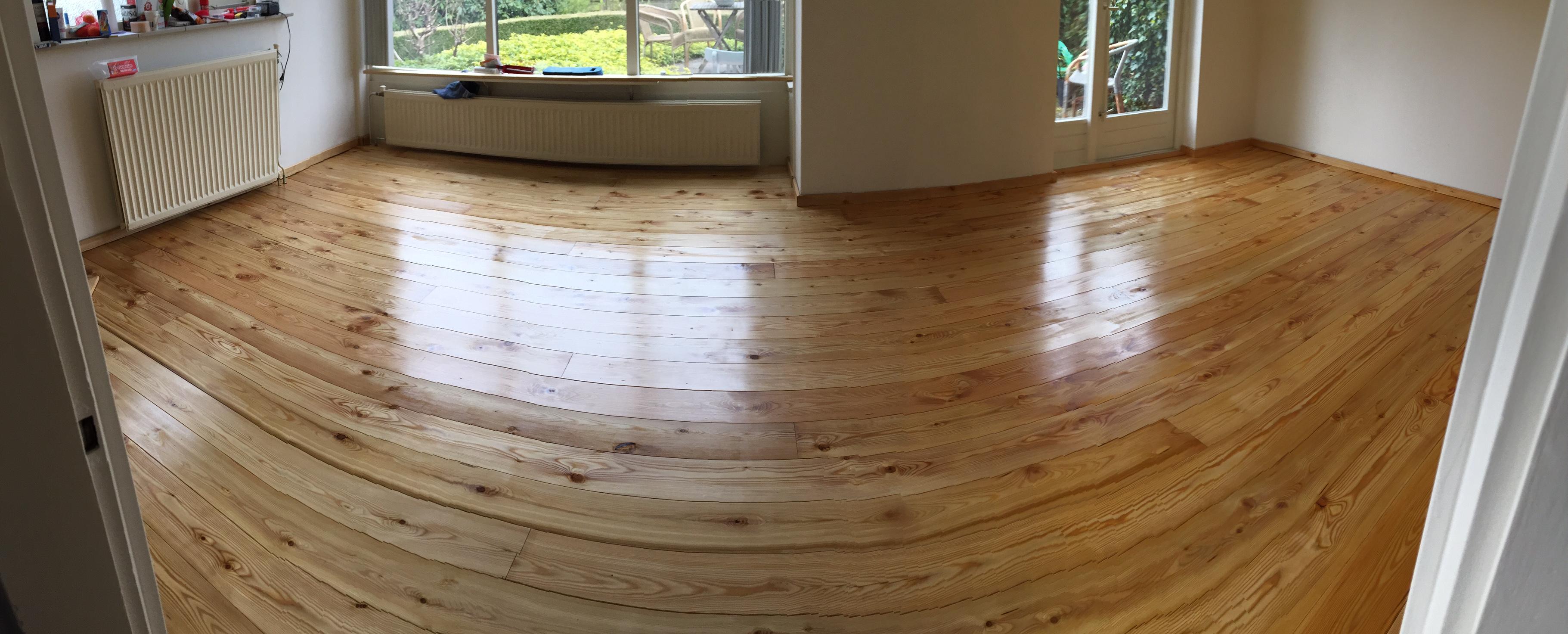 houten vloer tuinhuis leggen wooden floor pack for log cabins